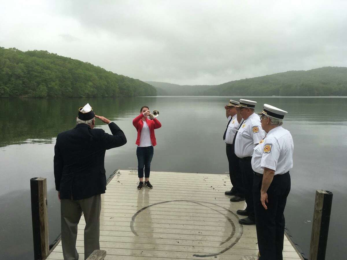 Sarah Wojtaszek plays Taps on Memorial Day 2020. In place of traditional activities, state musicians organized a playing of Taps along the Housatonic River from Long Island Sound to the Massachussets state line.