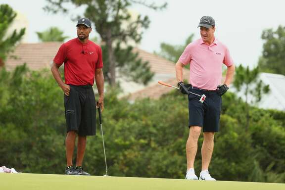 HOBE SOUND, FLORIDA - MAY 24: Tiger Woods and former NFL player Peyton Manning look on from the fourth green during The Match: Champions For Charity at Medalist Golf Club on May 24, 2020 in Hobe Sound, Florida. (Photo by Mike Ehrmann/Getty Images for The Match)