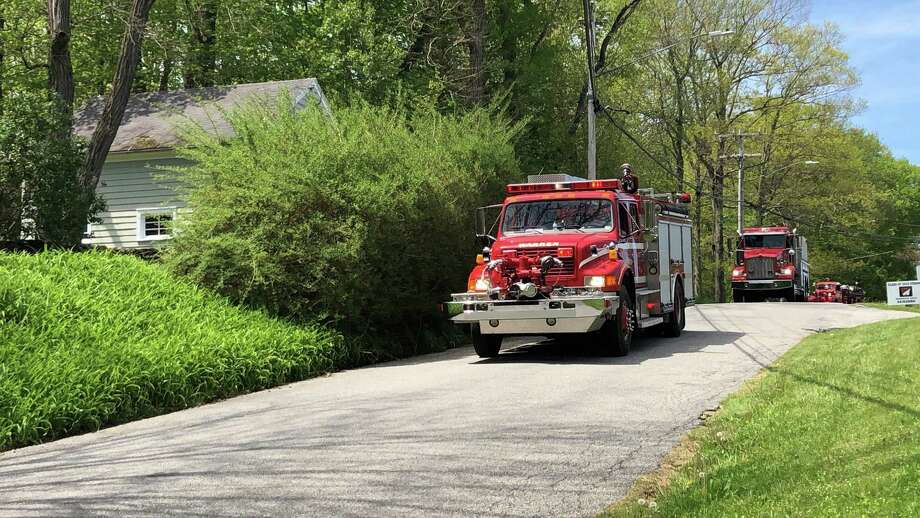 A firetruck leads the town-wide parade down Sackett Hill Road in Warren Sunday. Photo: Deborah Rose /Hearst Connecticut Media / Danbury News Times