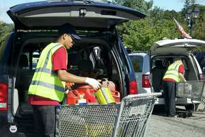 Items are removed from participating vehicles during a hazardous waste collection day in New Milford, Conn.
