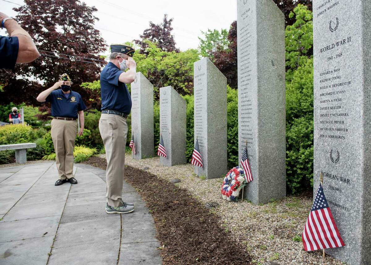 American Legion members salute the names of Wilton veterans who gave their lives in service to their country. May 25, 2020.