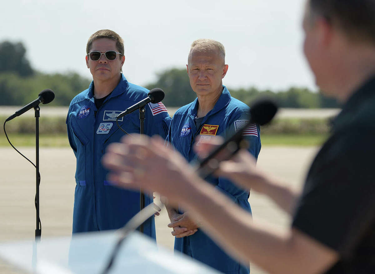 Behnken and Hurley will join a crew of one astronaut and two Russian cosmonauts already aboard the station. How long the new arrivals will stay is unclear but it's estimated they will remain at ISS from one month to four months.Pictured above: NASA astronauts Robert Behnken, left, and Douglas Hurley listen as NASA Administrator Jim Bridenstine gives remarks after the crew arrived at the Launch and Landing Facility at NASA's Kennedy Space Center ahead of SpaceX's Demo-2 mission, Wednesday, May 20, 2020, in Florida.