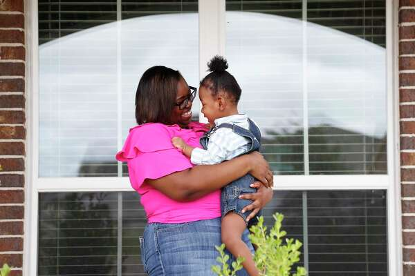 Aisha Atkinson with her two-year-old son, Aries, at home, in Rosenberg, Saturday, May 16, 2020. Aries was born at 23 weeks gestation. He had two massive brain bleeds and spent 150 days in the NICU. He will have chronic hydrocephalus and cerebral palsy his entire life, doctors estimate. Aries is one out of four babies to use a new device called CTOT, which is a wearable imaging device for awake infants with brain disorders. It was made using night-vision goggle technology, near-infrared light and high-resolution detectors. The device (which is a cap with wires) is used so babies don't have to be put under anesthesia which is super risky for them.