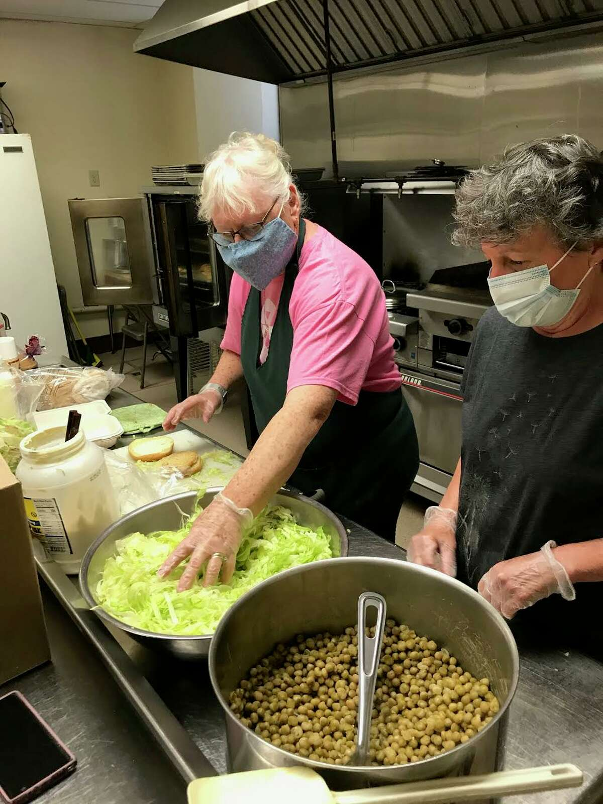 Head cook Kathy Purello, left, and helper Mary Bousquet, have volunteered at the Sacred Heart Friendship Table and food pantry for years.