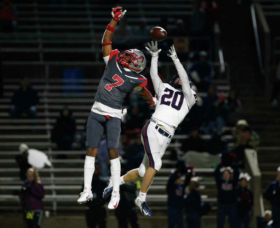 Travis Tigers strong safety Cam Moore (7) breaks up a pass intended for Tompkins Falcons fullback Garrett Mack (20) during the second half of the high school football playoff game between the Tompkins Falcons and the Travis Tigers at Mercer Stadium in Sugar Land, TX on Thursday, November 14, 2019. The Falcons defeated the Tigers 35-28. Photo: Tim Warner, Houston Chronicle / Contributor / ©Houston Chronicle
