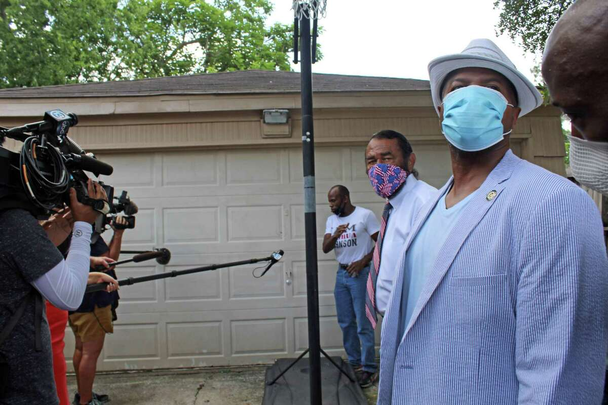 A witness shows reporters and community leaders where a bullet was found by neighbors following an officer-involved shooting that happened in Missouri City last April. Congressman Al Green joined with family members who called for an outside investigation at a press conference held Wednesday, May 20.