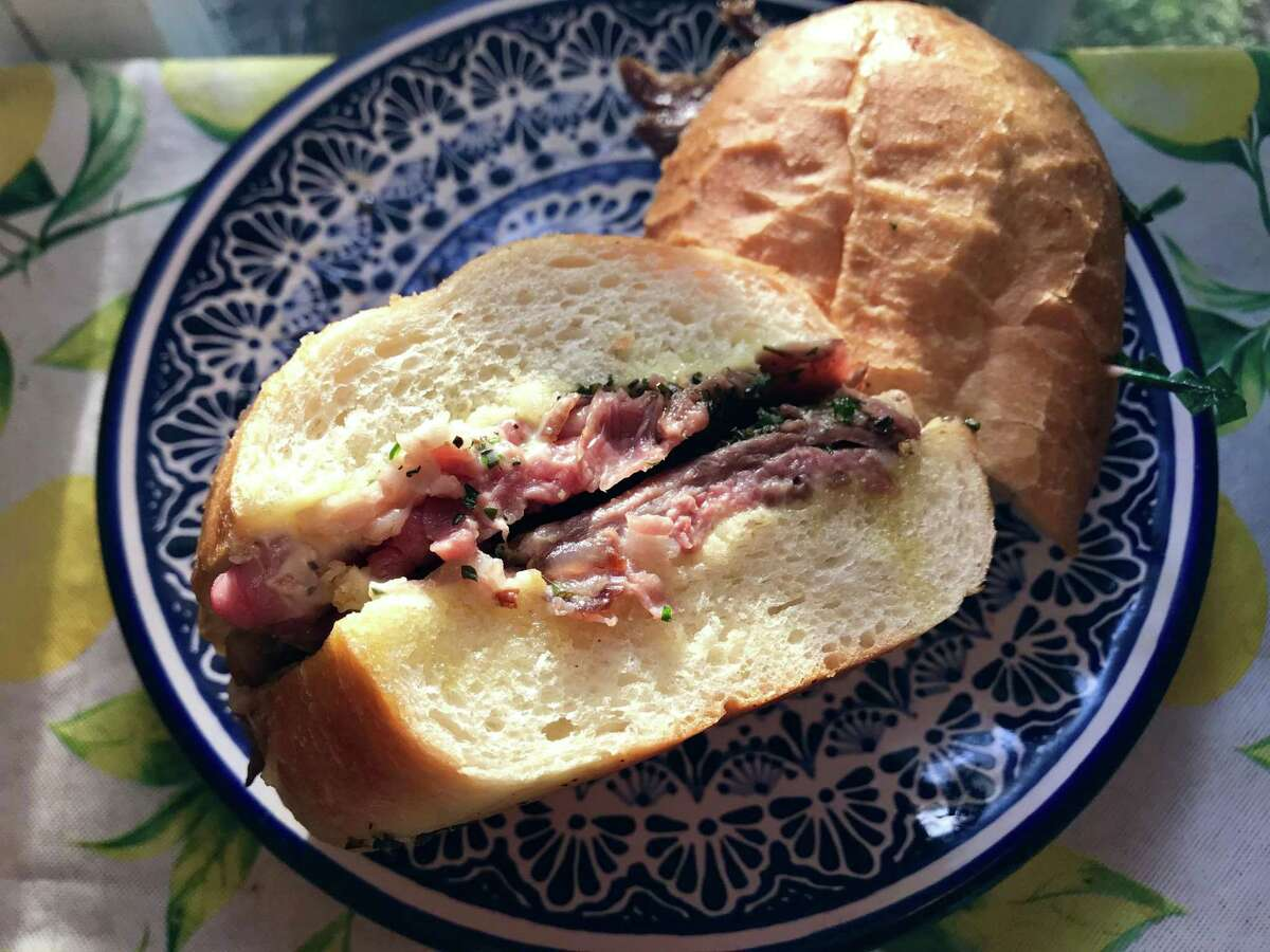 French Dip of sliced prime rib, aioli and persillade with mushroom jus from the
