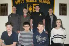 Amity students, standing, from left, Quinn Cunneen, Gregory Hofstatter, Michael Crisci, Mark Sheehe; kneeling, from left, Dan Mowerman, Benjamin Wang, Adrian Frankiewicz, Moorea Santulli.