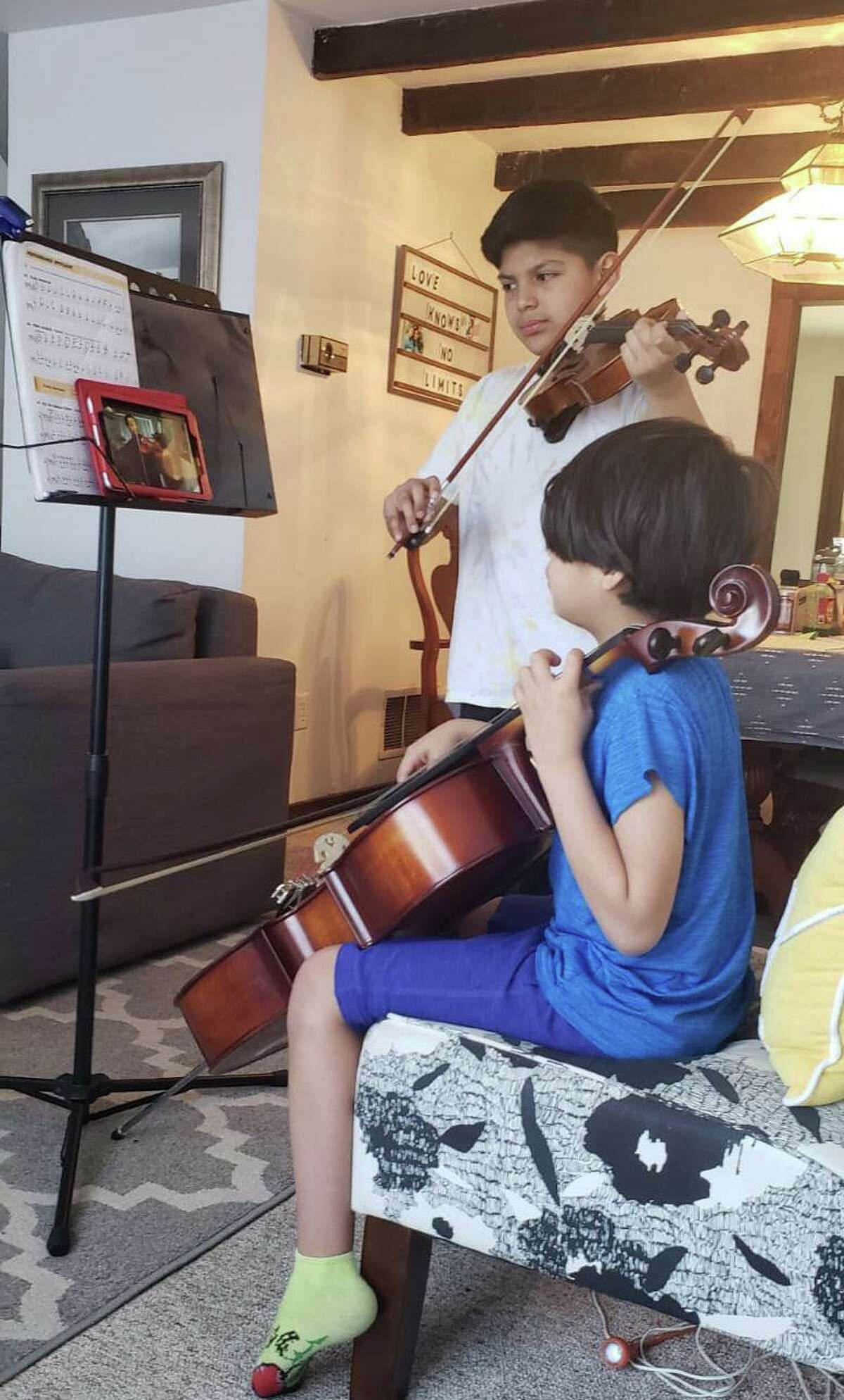 Siblings Nathaniel (left, violin) and Eduardo (right, cello) receiving an online music class from INTEMPO's teaching artist, Colin Benn. They are practicing the Brazilian repertoire for the upcoming online Cultural Crossover Concert on Saturday May 30 at 7 p.m. via Facebook and YouTube Live. INTEMPO's mission is to make intercultural music education and literacy relevant, accessible, and inclusive. It's students come from 4 different towns and 34 different schools in Fairfield County. To learn more, visit: www.intempo.org