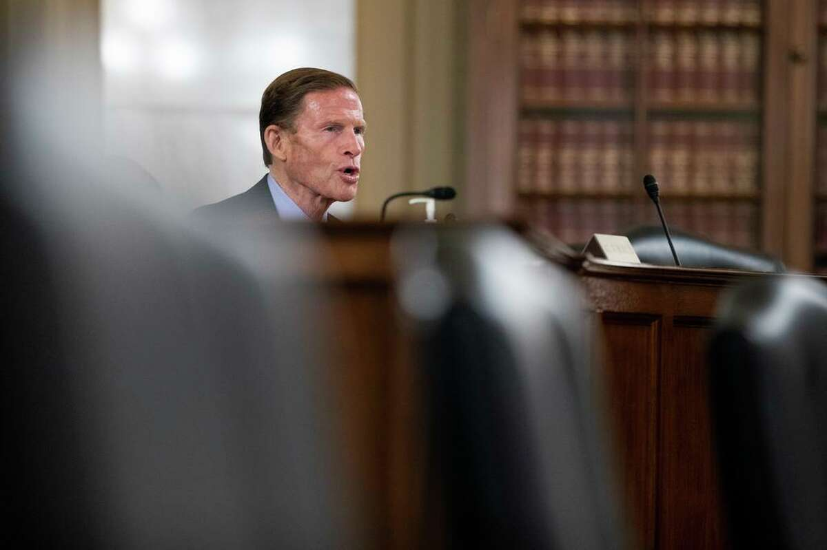 Senate Special Committee on Aging member Sen. Richard Blumenthal, D-Conn., speaks behind empty chairs during a hearing to examine caring for seniors amid the COVID-19 crisis on Capitol Hill, Thursday, May 21, 2020, in Washington. (AP Photo/Manuel Balce Ceneta)