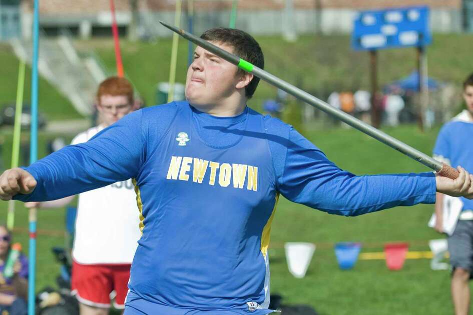 Peter Manfredonia, when he was a sophomore at Newtown High School, throws the javelin at the O'Grady Relays track meet at Danbury High School on Saturday, April 27, 2013
