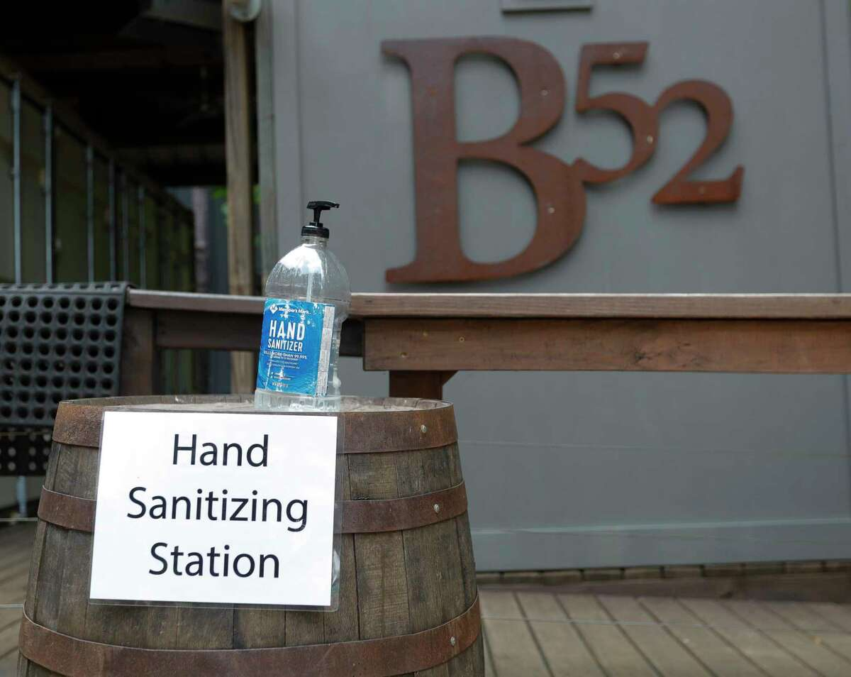 Hand sanitizing stations are seen through out B-52 Brewing, Wednesday, April 20, 2020, in Conroe. The Brewery reopens to customers Friday with social distancing and other guidelines under Gov. Greg Abbott's phased reopening of the economy.