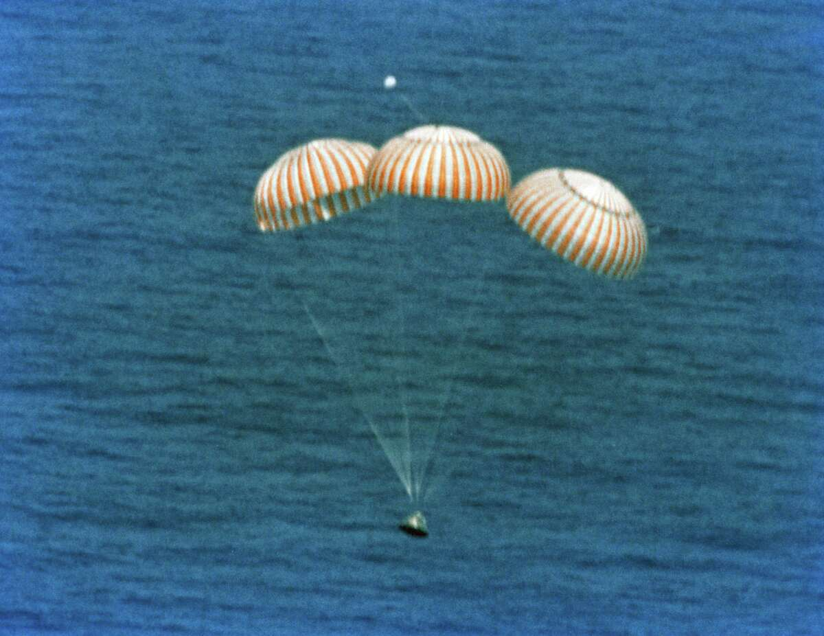An Apollo space capsule landing in the Pacific Ocean near Hawaii in 1975.