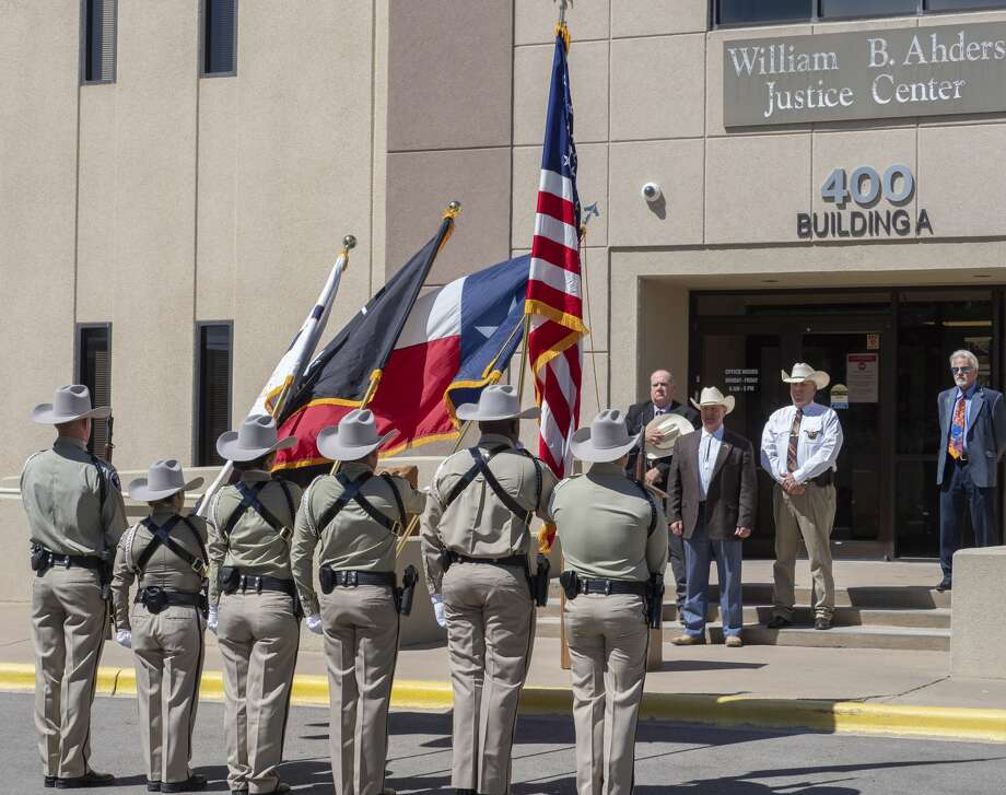 Midland County Sheriff Honor Guard members present the colors 05/26/2020 during the flag retirement ceremony in honor of the late Sheriff Gary Painter. Tim Fischer/Reporter-Telegram Photo: Tim Fischer/Midland Reporter-Telegram