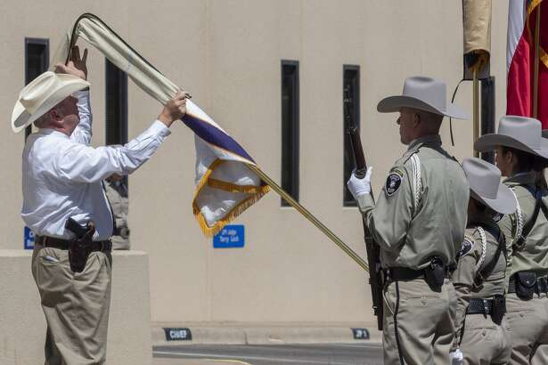 Sheriff Chief Deputy Benny Matlock places the cover over the Honor Guard Flag 05/26/2020 during the flag retirement ceremony in honor of the late Sheriff Gary Painter. Tim Fischer/Reporter-Telegram
