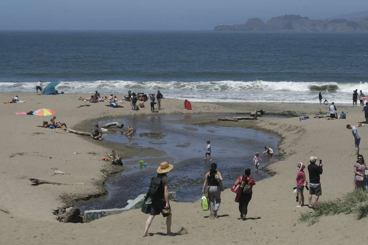 People visit Baker Beach during the coronavirus outbreak in San Francisco, Sunday, May 24, 2020.