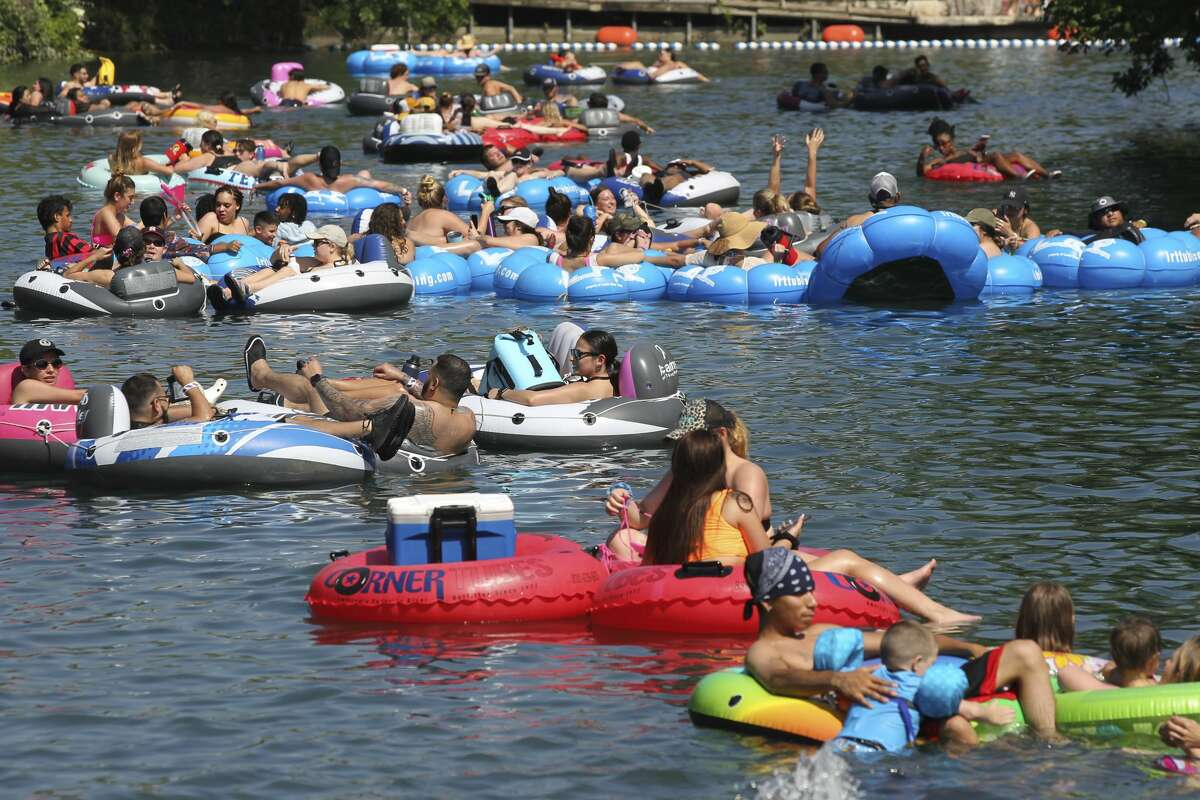 Tubers take to the Comal River at HInman Island Park in New Braunfels on May 20, 2020.