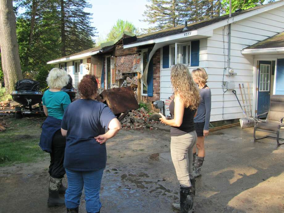Left to right, Annette Glenn, Jeanette Snyder, Lisa McGaugh and Sara Ladwin observe the damage done to Ladwin's lakefront home by flooding earlier that week, on May 23, 2020 in Sanford. (Mitchell Kukulka/Mitchell.Kukulka@mdn.net) Photo: Mitchell Kukulka