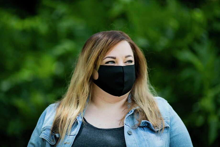 Kara McIntyre, 39, wears a mask on Saturday, May 23, 2020, in Jersey Village, as an extra precaution despite the fact that the last time she tested for COVID-19 it returned negative. McIntyre tested positive for COVID-19 in March. She later recovered and was tested a second time, with a negative result. Photo: Marie D. De Jesús, Houston Chronicle / Staff Photographer / © 2020 Houston Chronicle