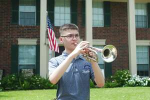 """Victory Lakes Intermediate School student Marshall Calderon participates in the """"Taps Across America"""" program on Monday by playing """"Taps"""" at 3 p.m. in honor of fallen heroes during Memorial Day."""