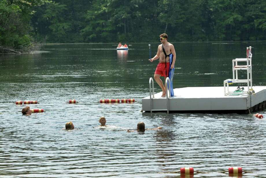 Lifeguard Chris Levene keeps a watchful eye on swimmers heading out to the raft at Topstone Park in Redding, Conn. on Monday, August 21, 2017. Photo: Cathy Zuraw / Hearst Connecticut Media / The News-Times