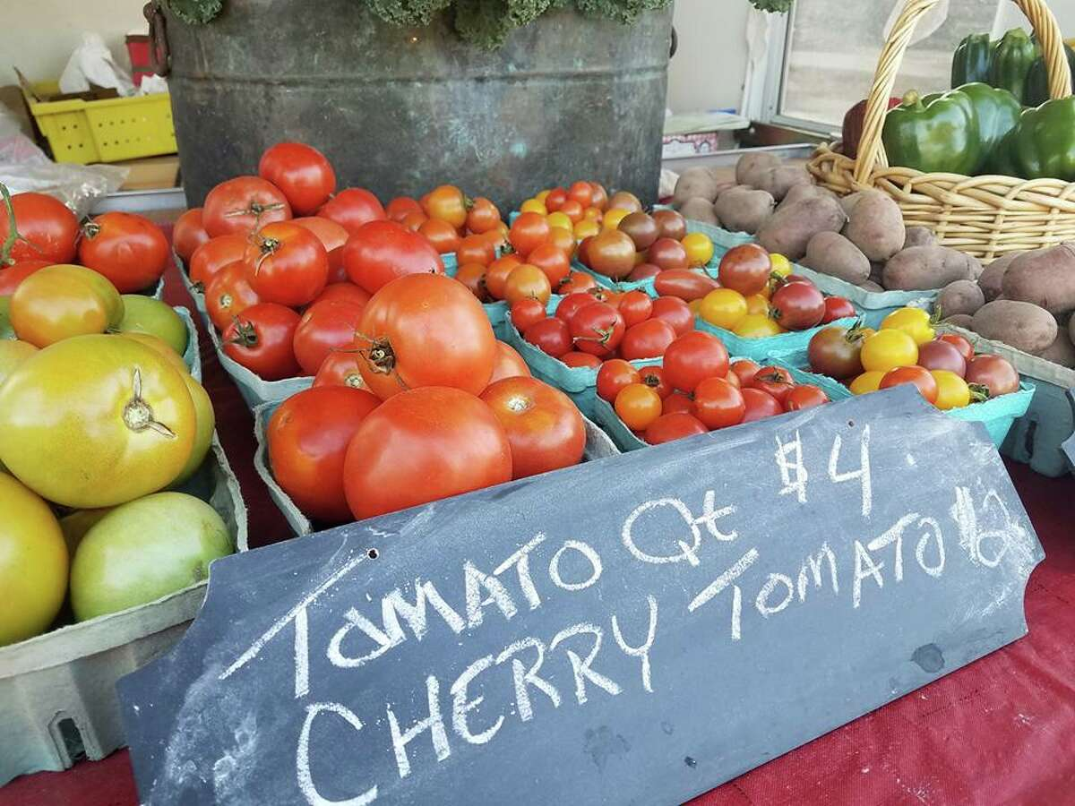 Fresh tomatoes are pictured at a booth during a visit to the Big Rapids Farmer Market last year. The market is expected to open June 16.