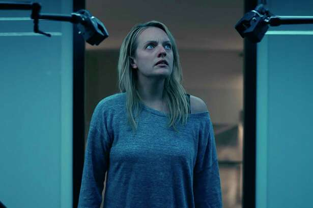 """Elisabeth Moss sees through her abusive husband in """"The Invisible Man."""""""