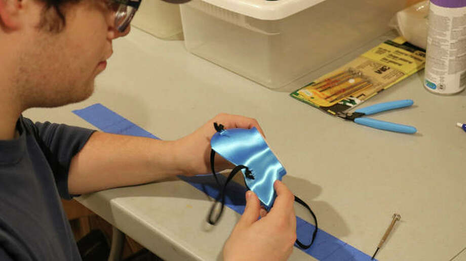Sam Lewis makes a mask using his 3D printer. Thanks to donations, the masks are given away to local medical professionals as part of The Mask Project Edwardsville.