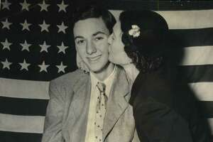 Hearst - Contests - History. Mrs. Esther Levy, of New Rochelle, New York, emplants a kiss on her elder son, Fred, on announcement of his victory in the Hearst Newspapers American History Contest among thousands of students from coast to coast. Fred topped the national standings with a 92.8 mark and won the $2,000 grand prize. The Levys came to America in 1937 as refugees from Nazi Germany and, as a result, Fred is doubly appreciative of the lessons of freedom found in United States history.