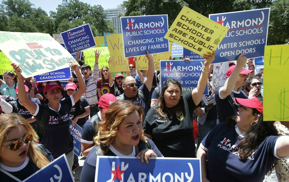 Supporters of charter schools cheer Gov. Greg Abbott during a 2015 rally in Austin. Charter schools have helped improve public education as a whole.