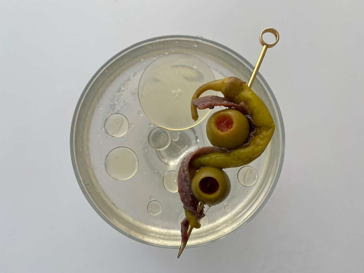 Cantabrian anchovy, pickled piparra peppers and manzanilla olive for a gildatini cocktail.