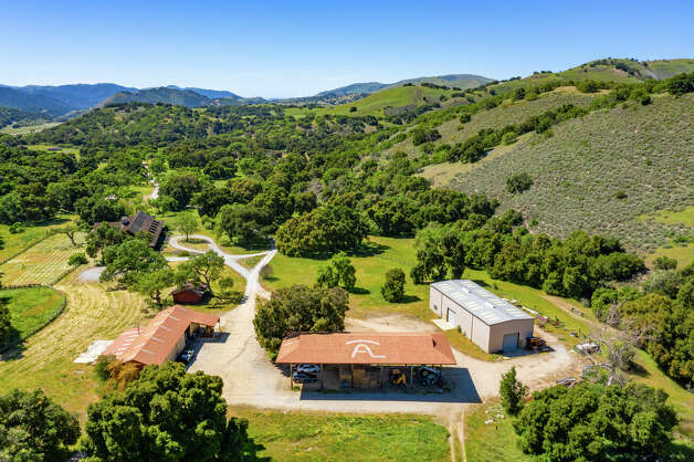 """All the fixings of a working ranch are included with this property. There are several barns, equipment storage, a greenhouse, corrals, fencing and equestrian facilities including a large riding arena. There are endless trails for horseback riding around the property and McDavid said that riding """"has been the single biggest pleasure of owning the ranch,"""" for Markkula. """"That's where he learned to ride horses,"""" he said. Photo: Courtesy Hall And Hall"""