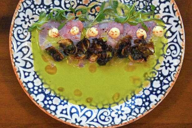 Dishes include hamachi crudo at Frida Mexican Restaurant & Bar to Stone Oak on San Antonio's North Side.