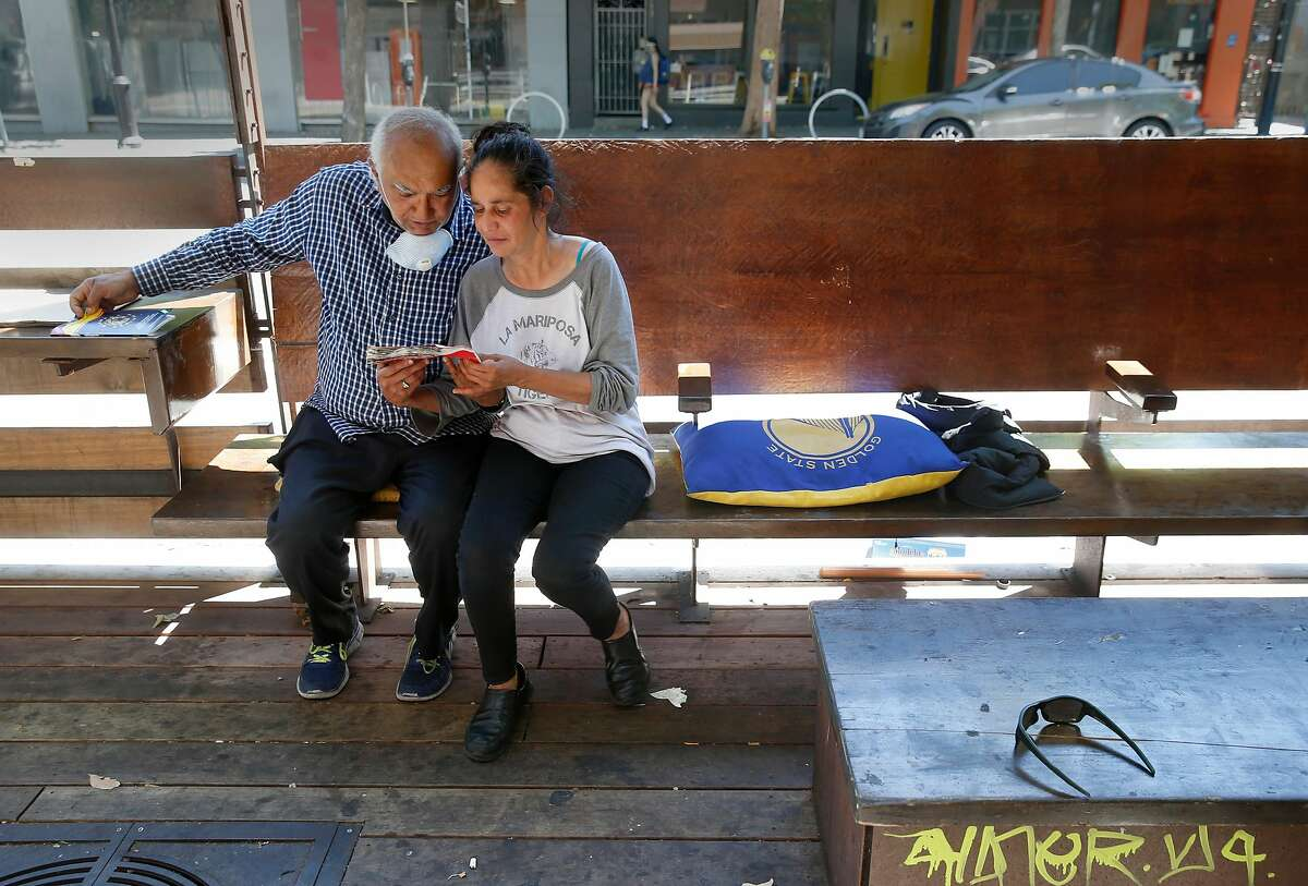 Saied Abdullah and Alejandra Azevedo sit in a parklet on Valencia Street in San Francisco, Calif. on Tuesday, May 26, 2020. The city may allow restaurants to serve meals in the parklets which are generally open to the public.