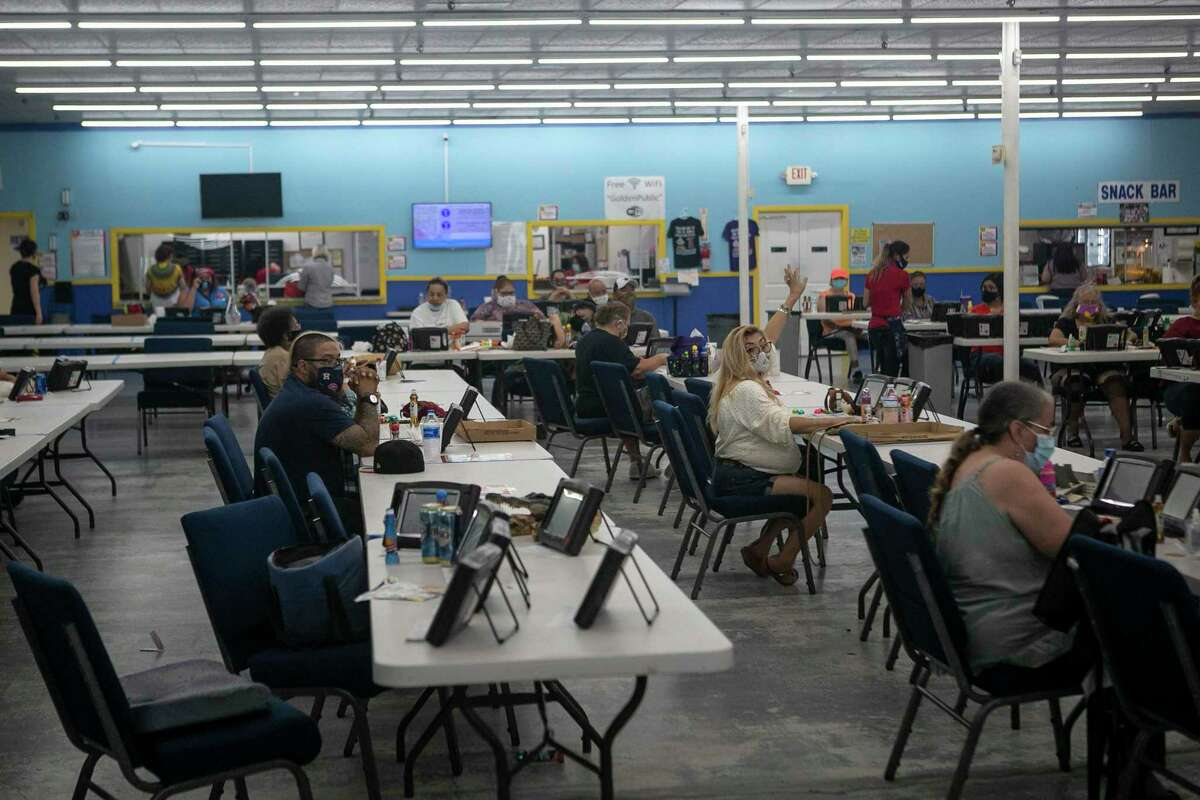 Players sit spaced out in the original Golden Bingo hall. Bingo halls reopened on Friday per state guidelines at 25 percent capacity with social distancing.