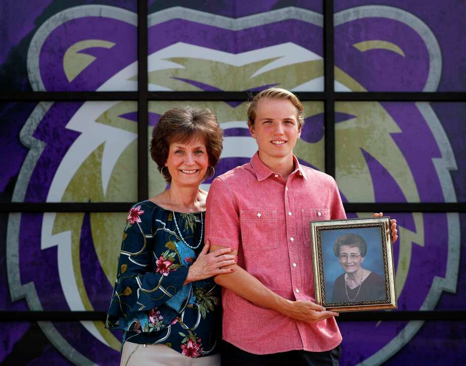 Montgomery High School senior Seth Reissig, poses for a portrait with his mother, Carol, while holding a portrait of his late grandmother, Dolores Hoffart, at Montgomery High School, Wednesday, May 6, 2020, in Montgomery. All three generations graduated valedictorian of their class at Montgomery High School. Seth's mother graduated in 1980, while his grandmother graduated in 1952. Photo: Jason Fochtman, Houston Chronicle / Staff Photographer / 2020 © Houston Chronicle