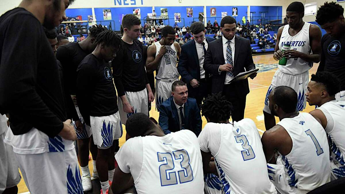 Albertus Magnus coach Mitch Oliver speaks to his team during a timeout during a recent game.