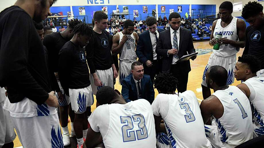 Albertus Magnus coach Mitch Oliver speaks to his team during a timeout during a recent game. Photo: Ron Waite / Photosportacular / RON WAITE