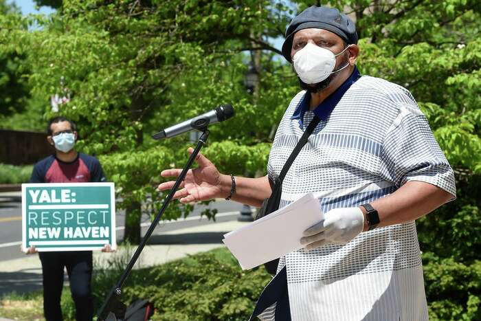 Rev. Scott Marks, Director of New Haven Rising, speaks at a protest rally to demand that Yale University and Yale New Haven Hospital make up the revenue lost due to their tax-exempt status in front of Yale University's Sheffield-Sterling-Strathcona Hall in New Haven on May 26, 2020.