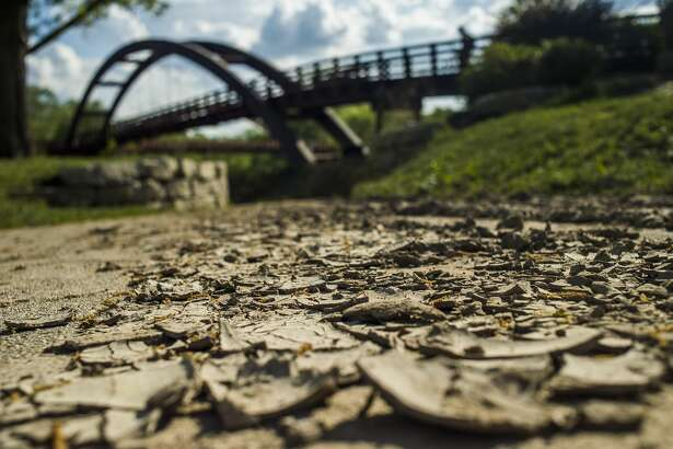 Although floodwaters have receded, dirt and sand remain,covering surfaces near theTridgein downtown Midland. (KatyKildee/kkildee@mdn.net)