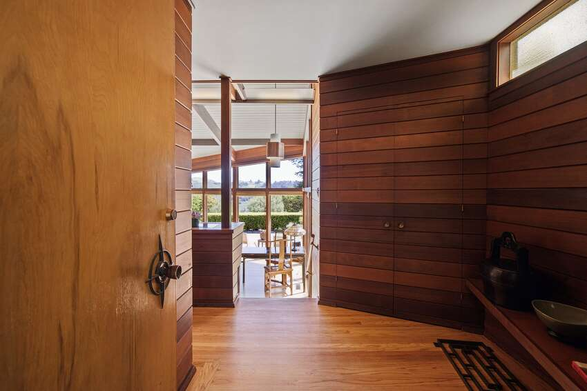The primary home was custom designed for the original owner in 1957 and still has many hallmarks of mid-century design including wood walls and ceilings, large glass windows, fireplaces and built-ins.