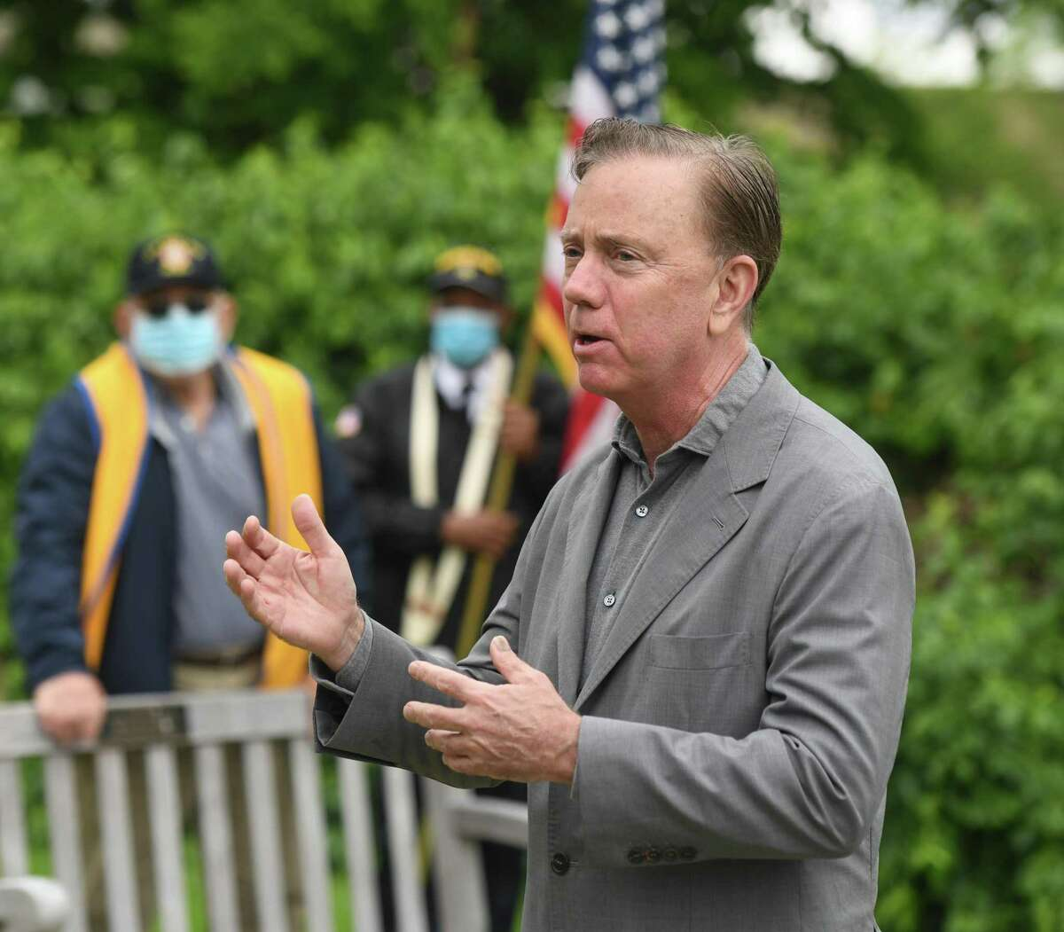 Connecticut Gov. Ned Lamont speaks during the Memorial Day cermony at the Cos Cob war memorial in Greenwich, Conn. Monday, May 25, 2020. Greenwich held Memorial Day ceremonies at the Indian Harbor Yacht Club, WWI and WWII monuments, Vietnam War monument, Eugene Merlot Park, and the Cos Cob war memorial to commemorate and remember the lives lost in battle.