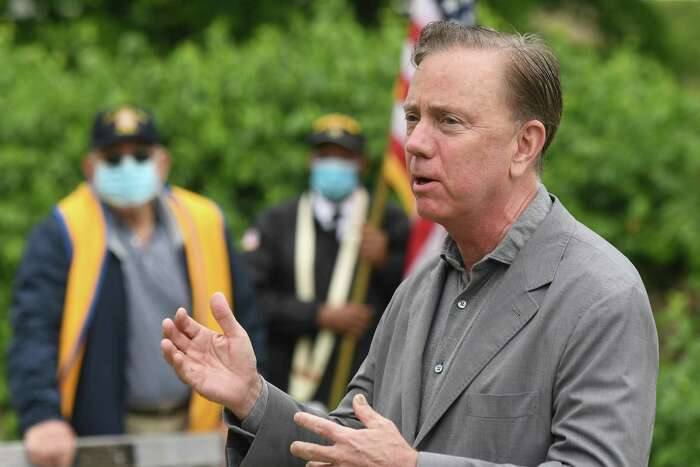 Connecticut Gov. Ned Lamont speaks during the Memorial Day cermony at the Cos Cob war memorial in Greenwich on Monday.