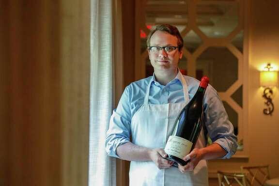 Brennan's sommelier Marcus Gausepohl with a 3-liter bottle of 2017 Morgon Jean-Paul Thévenet Morgon Vieilles Vignes