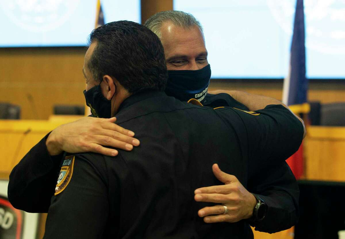 Pedro Lopez and Harris County Chief Deputy Edison Toquica hug each other after Lopez sweared in as HISD's new police chief Tuesday, May 26, 2020, in Houston. Lopez has more than 30 years of experience in law enforcement, including Houston Police Department and Harris County Sheriff's Office, where he and Toquica both worked.