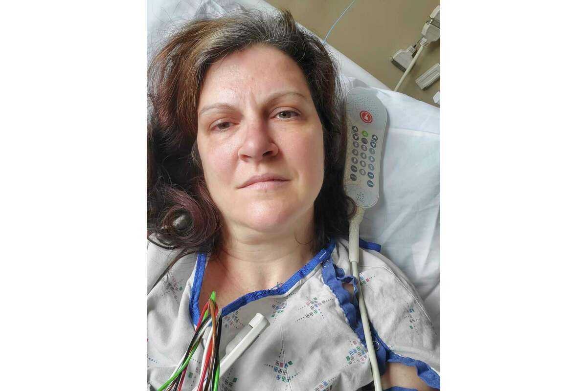 This May 6, 2020 photo provided by Darlene Gildersleeve, 43, of Hopkinton, N.H. shows her at a Manchester, N.H. hospital. Gildersleeve thought she had recovered from COVID-19. Doctors said she just needed rest. And for several days, no one suspected her worsening symptoms were related a€?