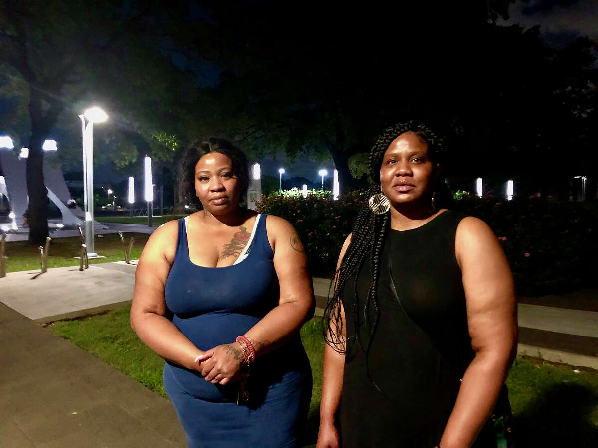 Roxie Washington, left, and her sister Paula Washington, right, stand in Houston's Emancipation Park on Tuesday, May 26, following a prayer vigil for George Floyd, a Houston man who was killed in Minneapolis police custody. Washington is the mother of Floyd's 6-year-old daughter, and she described him as a loving father.