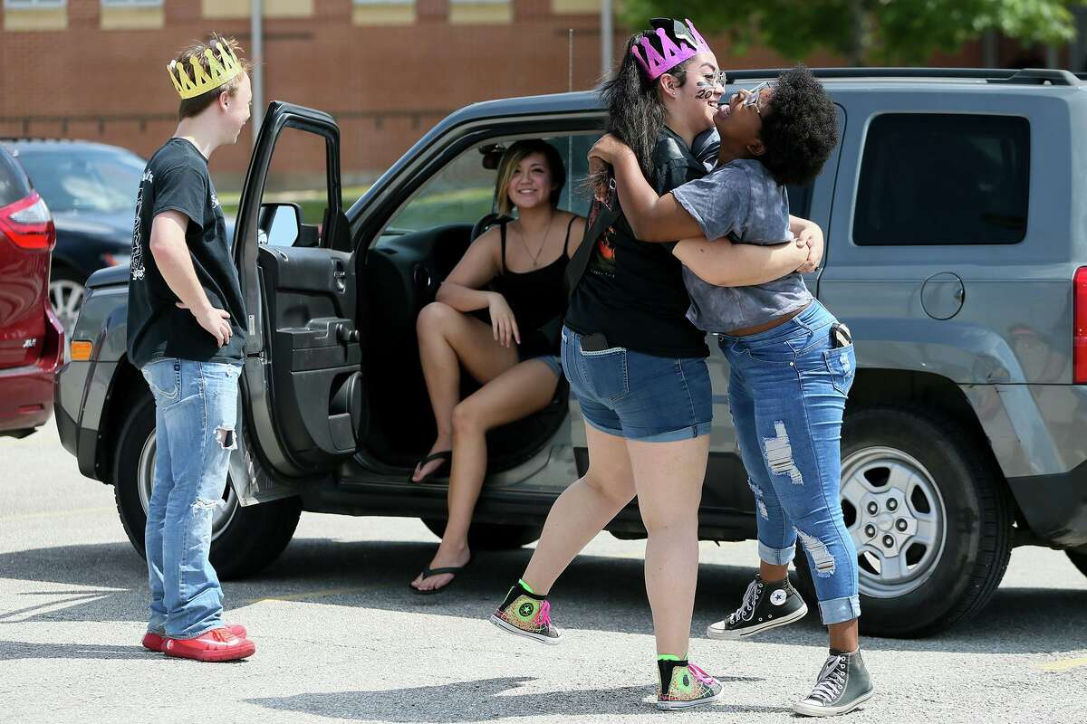 Mikayla Anthony, 17, right, and Evelyn Quiroz, 17, embrace as Steele High School seniors gather in the school's parking lot in preparation for a Final Bell Drive Away on what would have been the final day of school for the Class of 2020 on Friday, May 22.
