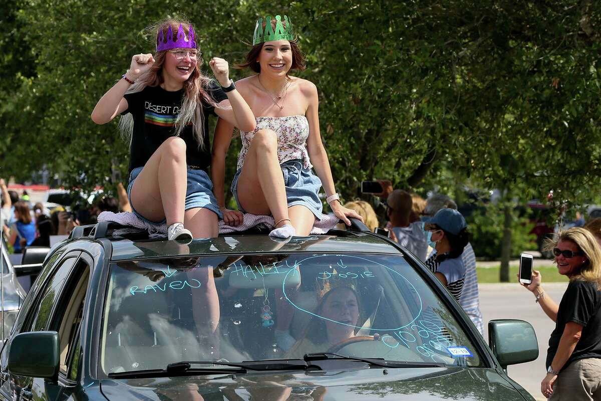 Steele High School seniors drive out of the school's parking lot as part of the Final Bell Drive Away on Friday, the day that would have been the final day of school for the Class of 2020. .