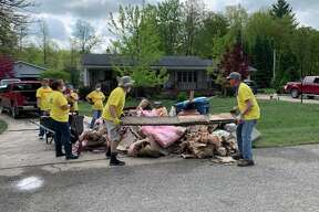 Residents and volunteers clean out homes devastated by flooding near Sanford Lake on May 23, 2020. (Mitchell Kukulka/Mitchell.Kukulka@mdn.net)